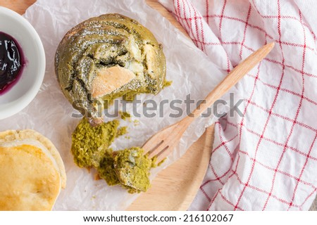 Green tea scone for tea time on wood table. - stock photo