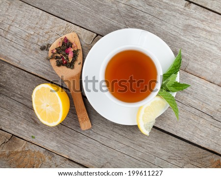 Green tea with lemon and mint on wooden table. View from above - stock photo