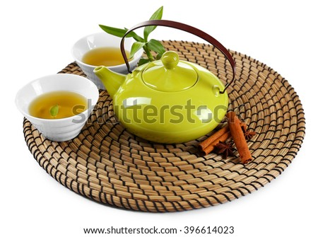 Green tea with utensils and spices, isolated on white - stock photo