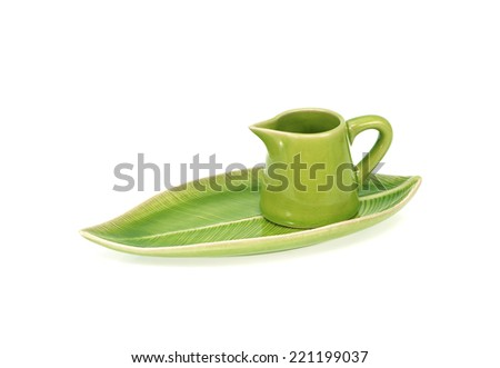 green teapot with saucer isolated on white background - stock photo