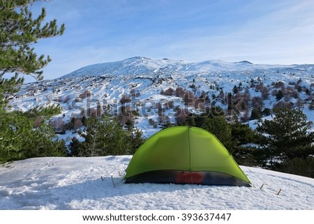 green tent in winter camp Etna National Park, Sicily - stock photo