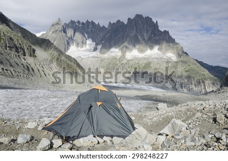 Green tent on the Leschaux glacier in the French Alps - stock photo