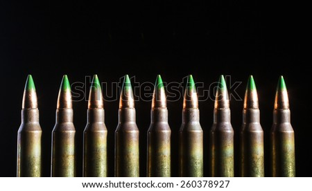 Green tipped bullets with steel inserts and the cartridges - stock photo