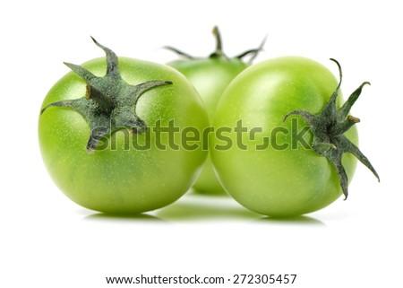 Green tomatoes on white background - stock photo