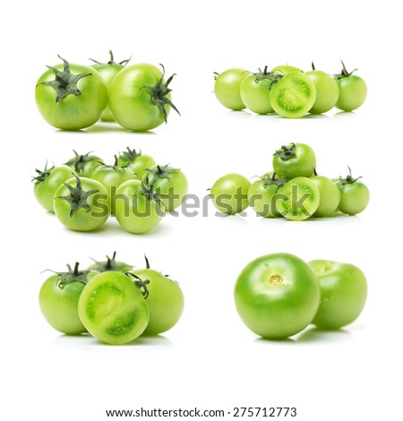 Green tomatoes on white background - stock photo