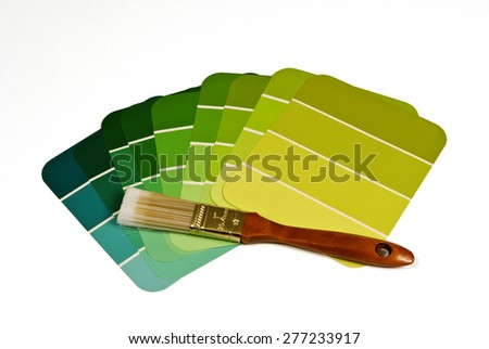 Green Tones Paint Samples And Paint Brush/ Paint Samples With Paint Brush - stock photo