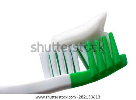 Green toothbrush with toothpaste. Isolated on white background. Close-up view. - stock photo