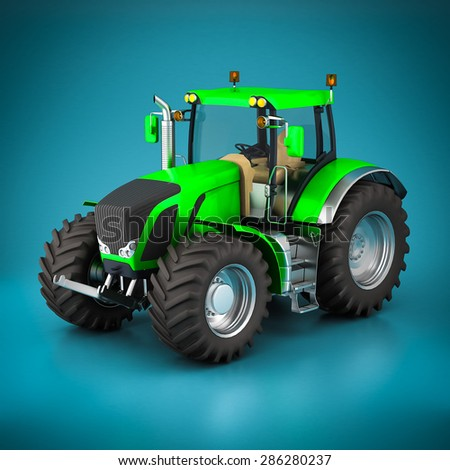 green tractor and white laptop on a blue background - stock photo