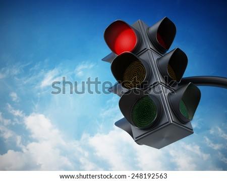 Green traffic light against blue sky. - stock photo
