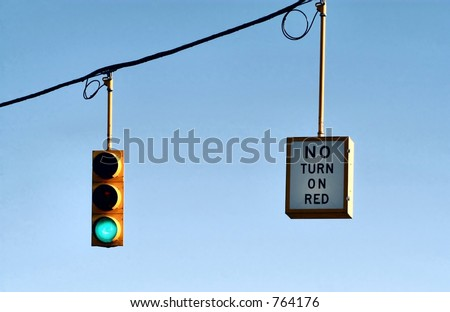 Green traffic light and No turn or red sign - stock photo