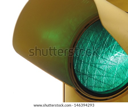 Green traffic light isolated on white background - stock photo