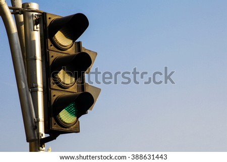 Green Traffic Light over blue sky background - stock photo