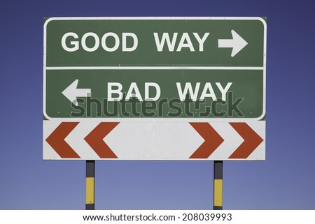 green traffic sign in front of a blue sky, horizontal arrows showing two directions and a red white road warning post. Business concept for activity and decision: Good Way, Bad Way - stock photo