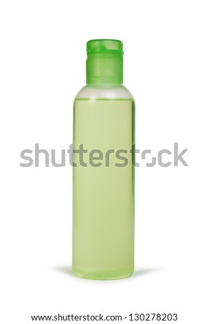 Green transparent cosmetic bottle. White isolated - stock photo