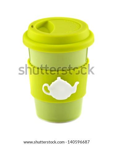 Green travel mug isolated on white background - stock photo