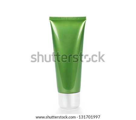 Green tube with cream isolated on white - stock photo