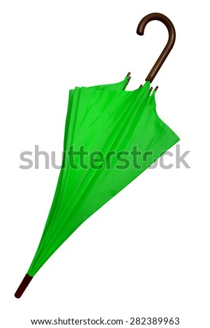 Green umbrella isolated on white background. Clipping path included. - stock photo