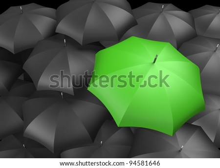 Green umbrella standing out from background of black umbrellas - stock photo