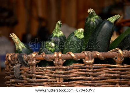 green vegetable marrows in a basket - stock photo