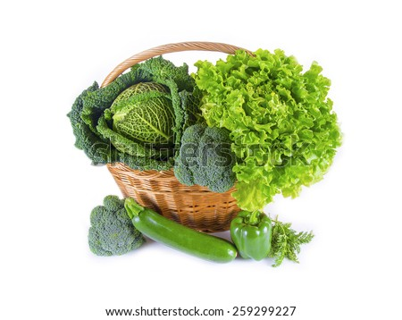 Green vegetables in basket - stock photo