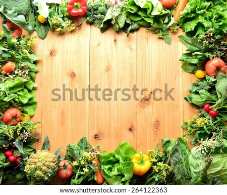 Green vegetables with colorful vegetables.frame.wooden background - stock photo