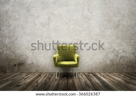 Green vintage chair in grunge room - stock photo