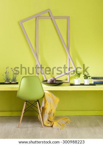 green wall interior work desk and green chair with yellow warp - stock photo