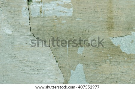 Green wall with a crack in the plaster. textural composition - stock photo