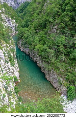 Green water at the bottom of a canyon, Montenegro - stock photo