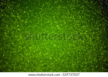 green water droplets from the sky on background - stock photo