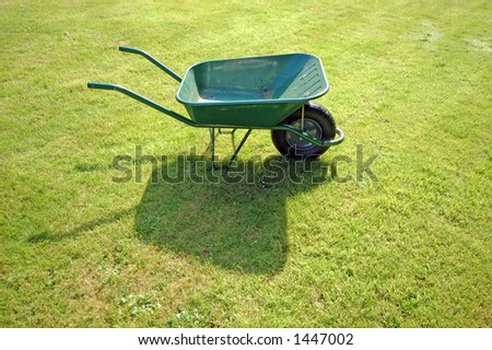 Green Wheelbarrow - stock photo