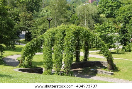 green wicker arbour in the park in summer - stock photo
