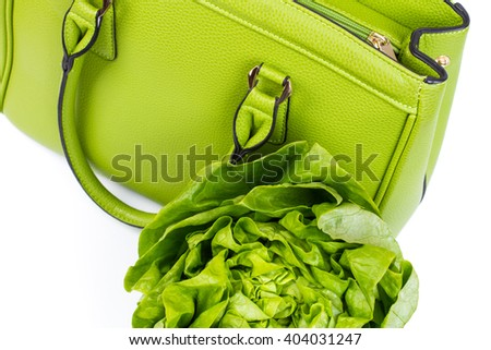 green woman bag with lettuce salad - isolated on white - stock photo
