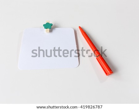 green wood paper clips with red pen- isolated on white background - stock photo