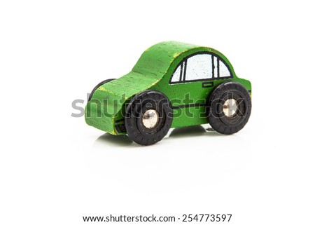 Green Wooden Car Toy seen from side on White Background - stock photo