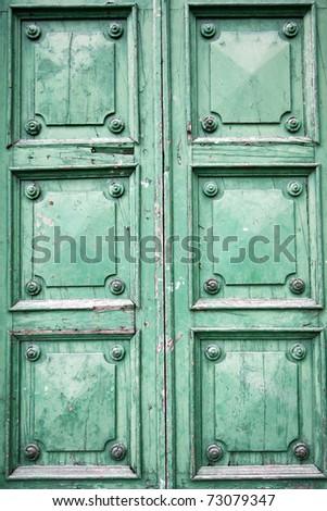 green wooden door - stock photo