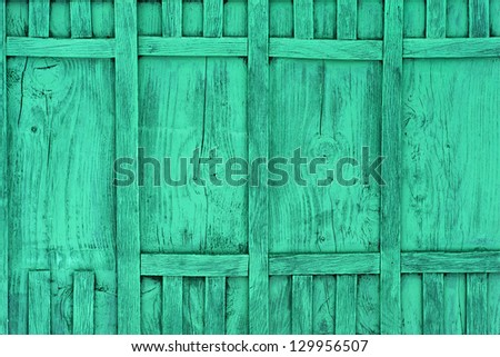 Green wooden fence - stock photo