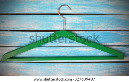green wooden hanger  on rustic wooden background  - stock photo