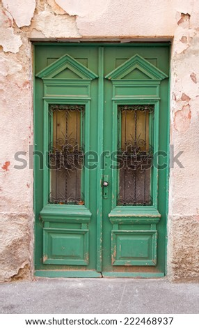 Green wooden old door, entrance of the house. - stock photo