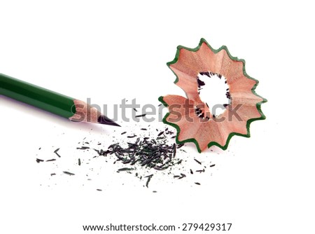 Green wooden pencil with sharpening shavings, isolated on white.Studio shot. - stock photo