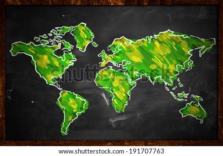 Green World Map Sketch On Blackboard - stock photo