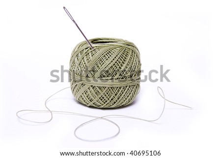 green Yarn spool with needle isolated on white background - stock photo