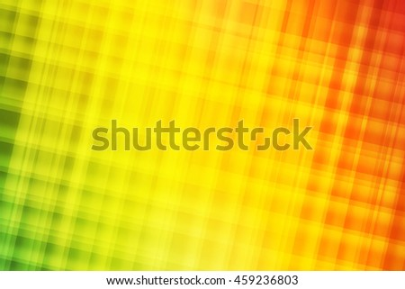 Green, yellow, orange and red blend to create abstract background  - stock photo