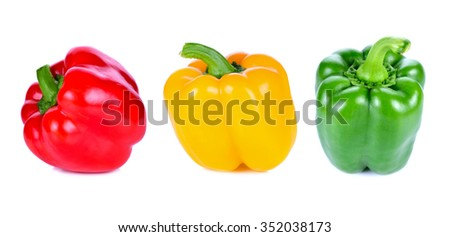 green yellow red pepper on white background - stock photo