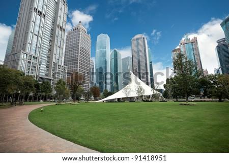 greenbelt park in shanghai financial center district - stock photo