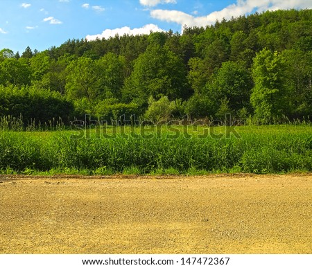 Greenery and road border with sky  - stock photo