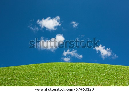 Greenery hill view with clear blue sky and cloud - stock photo