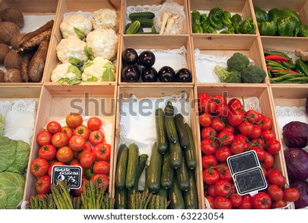 Greengrocer?s display with boxes full of fresh fruit and vegetables - stock photo