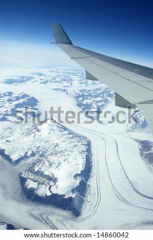 Greenland as seen from the sky - stock photo