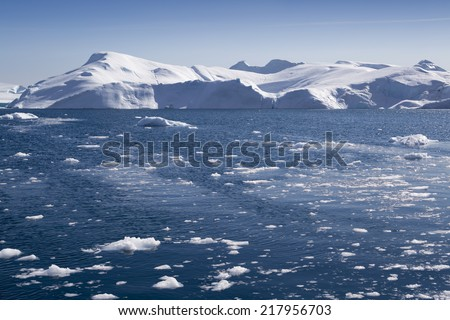 Greenland. The biggest glacier on a planet Jakobshavn. Huge icebergs of different forms in the gulf. Studying of a phenomenon of global warming. - stock photo